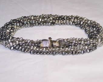 Vintage women necklace multi colored grey silvery beads.
