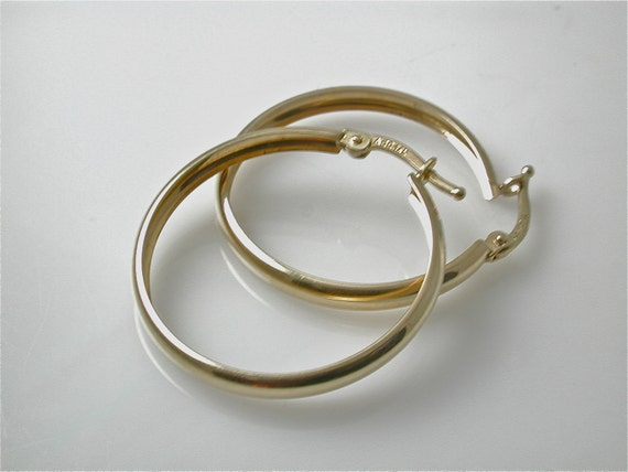 real 14 kt gold hoops 14 karat yellow gold hoop earrings. Black Bedroom Furniture Sets. Home Design Ideas