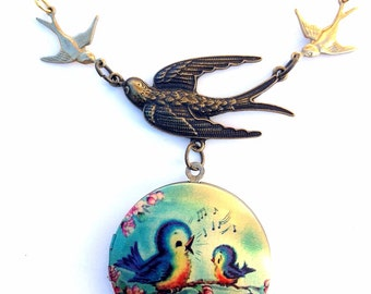 """Part of the Flock Singing Momma and Baby Bird Brass Locket on 20"""" gold plated chain w/ Raw Brass Stamping"""