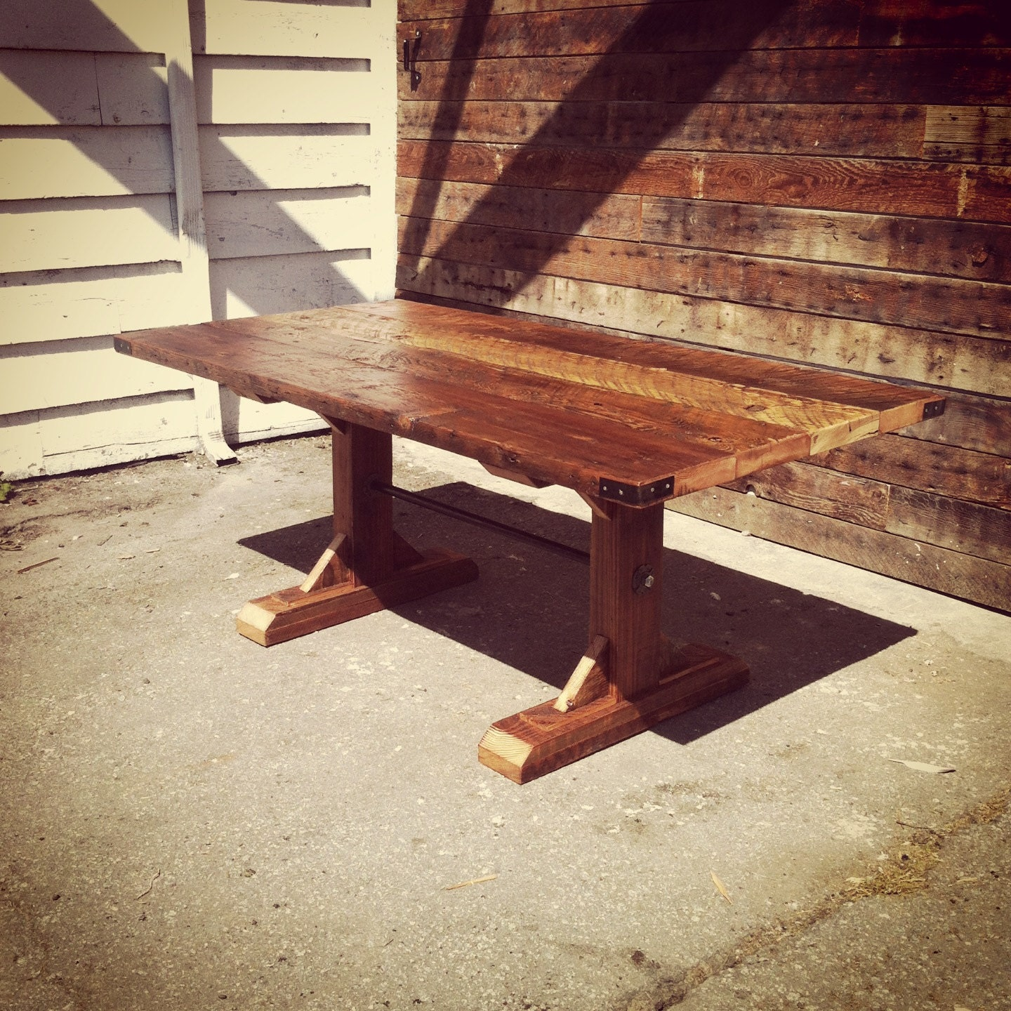 Reclaimed harvest table with trestle base