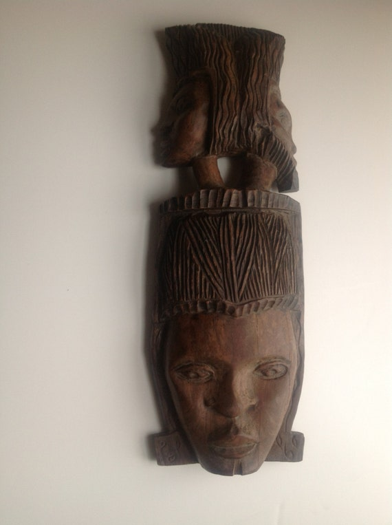 Heavy african ironwood hand carved faces