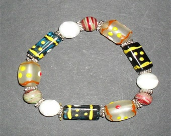 "Hand painted glass bead bracelet with silver tone metal star beads. Elasticized 7"". 3 different colors and styles."
