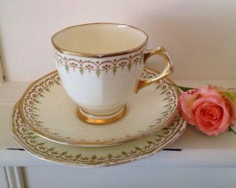 Vintage Art Deco Tea cup and saucer and side plate (tea cup trio) in tuscan plant bone china 1930's