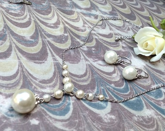 Silver and faux pearl necklace and earrings