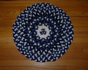 Blue and white, round, braided rug