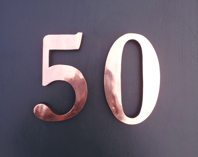 "Copper Block house numbers 4""/100mm, 6""/150 mm in Garamond font,   laquered, standoff/floating fitting"