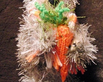 Knitted rabbit with a carrot and in scarf