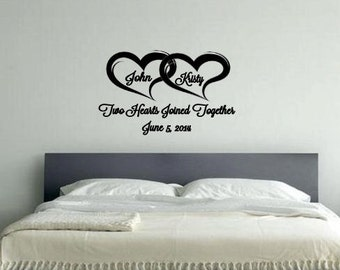 Two hearts joined together with names and establshed date vinyl wall decal
