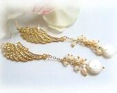 angel wings dangling earrings in gold