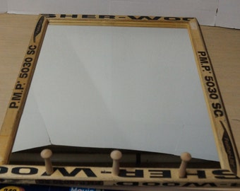 Hockey stick wall mirror