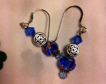 Sapphire Blue and sterling silver pierced earrings with Celtic knot beads.