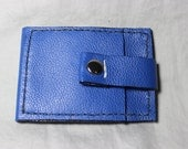 Blue, leather, slim, bi-fold wallet with snap closure.
