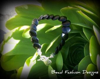 Black Onyx Lentil Overlap Coin Gemstone Beads, Clear Swarovsky Crystals,Sterling Silver Bracelet.