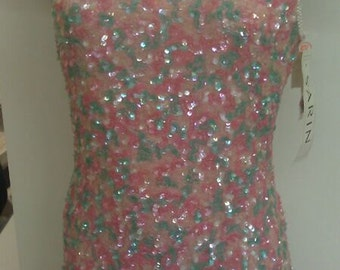 Pink and light green heavily sequinned dress on silk fabric hand beaded suitable both for party and evening wear.FREE SHIPPING inside USA !