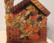 Vintage handmade house-shaped shelf, shale rock and wood