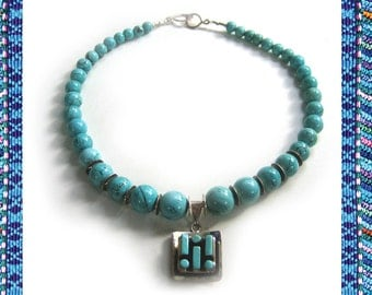 Four Corners: Turquoise and sterling silver pendant. Necklace and earring set.