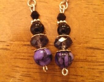 Purple and black beaded dangle earrings.