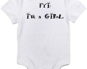 FYI I'm a Girl white onesie for baby