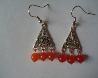 Sterling silver with orange accent glass beads.