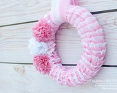 Ruffled wreath that may be used for weddings, birthday parties, baby showers, bridal showers, children's parties and home decor.