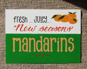 Fresh Juicy new seasons Mandarins sign.