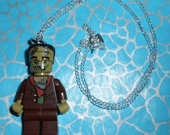 Hand Made Quirky FRANKENSTEIN Quirky Necklace New on a silver plated chain, made using a LEGO minifigure