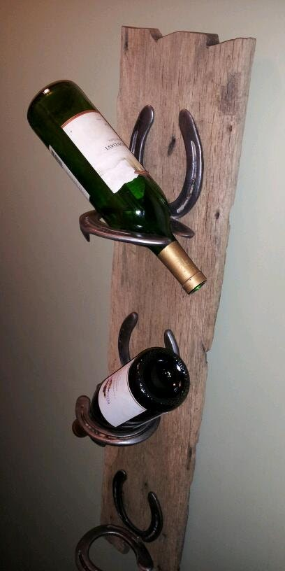 Rustic Wine Rack Made With Horse Shoes Attached To Old Barn