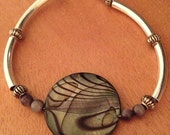 """Beaded Bracelet with a Round Stone Style Bead in the Center - 7"""""""