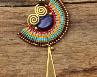 Woven cotton necklace with brass accents and lapis lazuli gemstone
