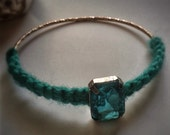 Free shipping. Gold bangle with turquoise yarn and turquoise rhinestone bead
