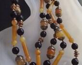 SANDRA DAVID black & amber tone beads triple strand necklace c. 1980s