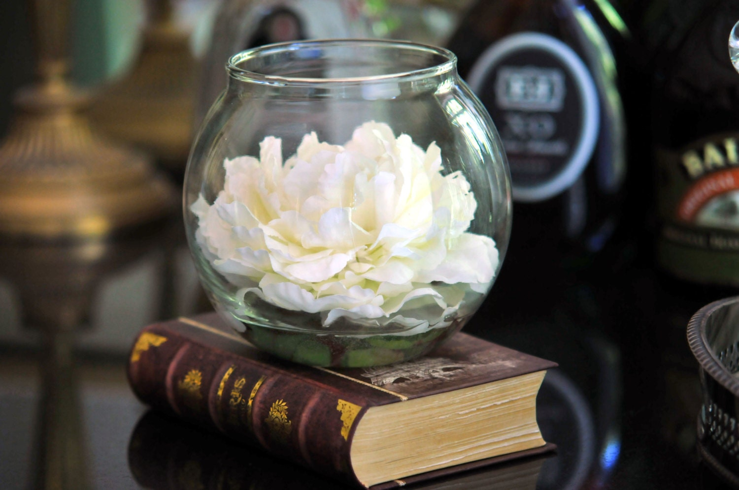 White peony in a glass bowl floating on an illusion water