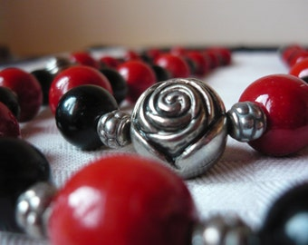 Black and red rose necklace in silver