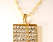 14K yellow gold diamond pendant  0.60 carats with free   ship.    M107982.