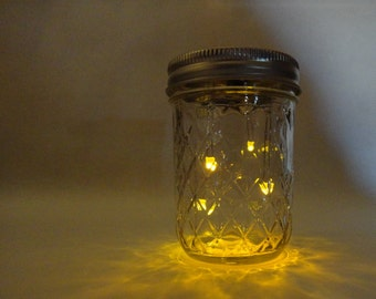 fireflies--an electronic animated firefly jar hand made by the designer in the US