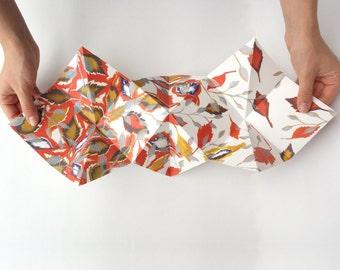 Blanco origami wenskaart met uniek kleurig dessin.