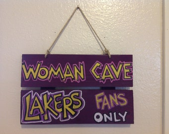 Lakers Woman Cave Sign