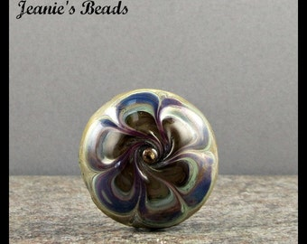 A handmade lampwork glass button with 2 shanks