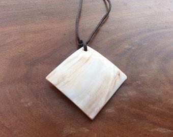 pretty natural  square shell pendant with dark brown cord