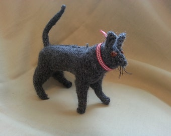 hand knitted grey standing cat
