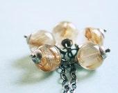 Captive Sun - golden RUTILATED QUARTZ cluster necklace on oxidised sterling silver
