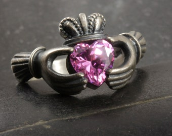 Antiqued claddagh ring with a pink cubic zirconium size 5