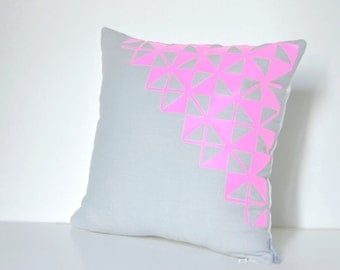 Grey linen pillow cover with neon pink design Inspired by origami.