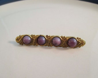 Gold Victorian Brooch with Purple Cabochon Stones