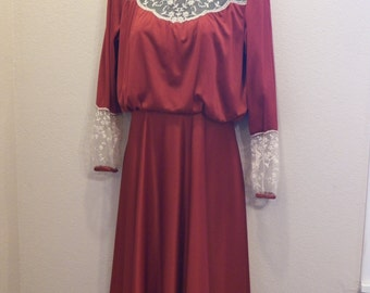 Vintage 70's Rust/Orange polyester knit dress with ivory lace