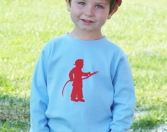 Little Fireman Long Sleeved Nostalgic Graphic Tee in Sky Blue with Red