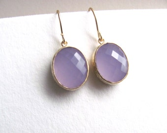 Tanzanite earrings, faceted glass in 16k gold plated frames on 14k gold fixtures