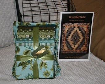 Quilt kit in teals and greens very modern looking.