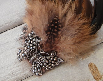 Brown  color  feather  clip with butterfly   buckle    1 piece listing