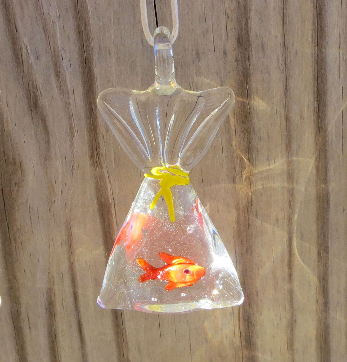 Tropical fish in a bag necklace by wave of life for Fish in a bag